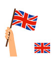 hand holding flag of britain vector image