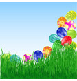 easter eggs roll into the grass vector image