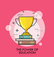 golden winner cup standing on stack of books vector image