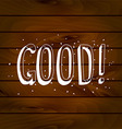 GOOD inscription on a wooden background vector image