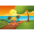 Three kids watching the lighthouse vector image vector image