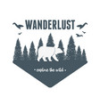 wanderlust label with forest scene and grizzly vector image