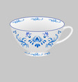 decorative porcelain tea cup ornate with blue vector image