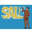 Businessman writing the word sale