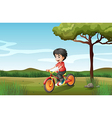 A boy biking at the hill vector image vector image