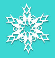 christmas paper snowflake on blue background vector image vector image