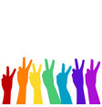 hands showing victory sign in rainbow colors vector image