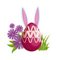 eggs painted with rabbit ears in the garden vector image