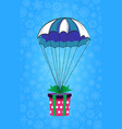 gift wrapped with green ribbon flying on blue and vector image