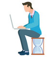 man sits on hourglass typing on laptop vector image vector image