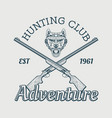 emblem for hunting club wolf head and guns vector image vector image