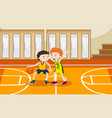 two boys playing basketball in the gym vector image vector image