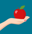 woman hand holding an apple vector image