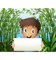A boy at the bamboo farm holding an empty signage vector image vector image
