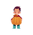 boy keeps big pumpkin isolated vector image vector image