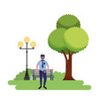 policeman standing in the park vector image