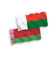 flags madagascar and belarus on a white