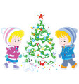children skating around a christmas tree vector image vector image