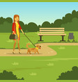 young woman walking with her dog in the park flat vector image