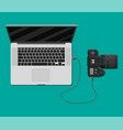 photo camera plugged to laptop usb port vector image vector image