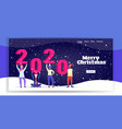 mix race people in santa hats holding number 2020 vector image