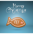 gingerbread fish and Merry Christmas title on blue vector image vector image