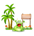 A monster in front of the empty wooden signboard vector image vector image