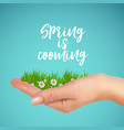 grass and flowers in hand spring is cooming vector image vector image
