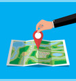 location pin in hand and paper map vector image