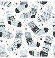seamless pattern with cute socks and snowflakes vector image vector image