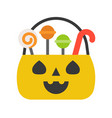 jack o lantern basket trick or treat with candy vector image vector image