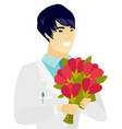 young asian doctor holding a bouquet of flowers vector image vector image