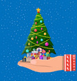 christmas tree decorated in hand and gift boxes vector image
