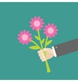 Businessman hand holding bouquet of pink daisy vector image vector image