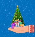 christmas tree decorated in hand and gift boxes vector image vector image
