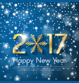 golden new year 2017 concept on blue snow blurry vector image vector image