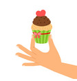 cupcake with red heart in hand vector image
