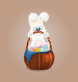 fluffy easter bunny with wicker basket full of vector image