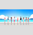 mix race people group on sunrise beach seaside vector image