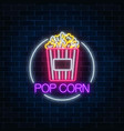 neon glowing sign of pop corn in circle frame on vector image