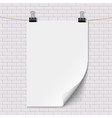 blank white paper poster hanging on brick white vector image vector image