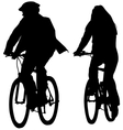 young couple riding bicycles silhouettes vector image vector image