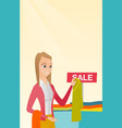young woman choosing clothes in the shop on sale vector image vector image