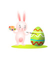 cute easter rabbit with colorful paint palette vector image vector image