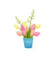 bouquet pink and yellow tulips stands in a blue vector image vector image
