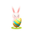 cute easter rabbit on green grass with gold egg vector image vector image