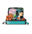 opened travel suitcase full of things for vacation vector image vector image