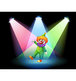 A clown under the spotlights vector image vector image