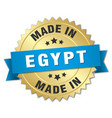 made in egypt gold badge with blue ribbon vector image vector image
