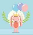 cute pink rabbit with crown holding balloons vector image